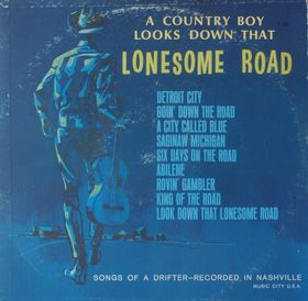 A COUNTRY BOY LOOKS DOWN THAT LONESOME ROAD